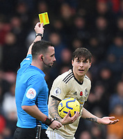 2nd November 2019; Vitality Stadium, Bournemouth, Dorset, England; English Premier League Football, Bournemouth Athletic versus Manchester United; Victor Lindelöf of Manchester United receives a yellow card from Referee Chris Kavanagh - Strictly Editorial Use Only. No use with unauthorized audio, video, data, fixture lists, club/league logos or 'live' services. Online in-match use limited to 120 images, no video emulation. No use in betting, games or single club/league/player publications