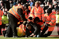Stewards take down a pitch invader during the Sky Bet Championship match between Aston Villa and Birmingham City at Villa Park, Birmingham, England on 11 February 2018. Photo by Bradley Collyer/PRiME Media Images.