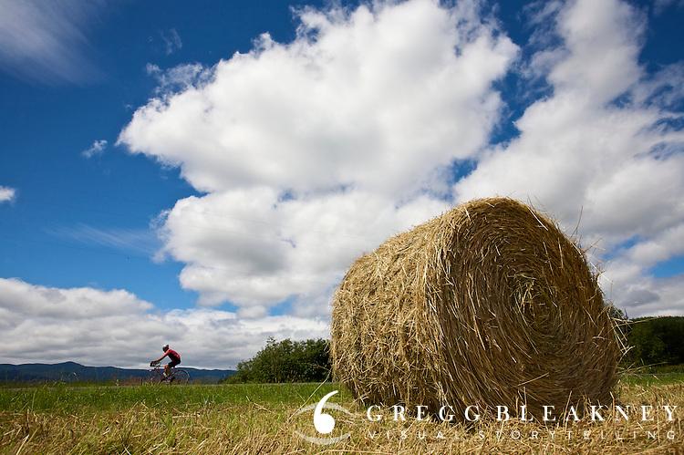 Road Cyclists Passes Hay Bail - Near Seattle - Washington - USA