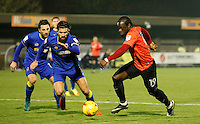 Brighton's Elvis Manu takes on the AFC Wimbledon defence during the The Checkatrade Trophy match between AFC Wimbledon and Brighton & Hove Albion Under 21s at the Cherry Red Records Stadium, Kingston, England on 6 December 2016. Photo by Carlton Myrie / PRiME Media Images