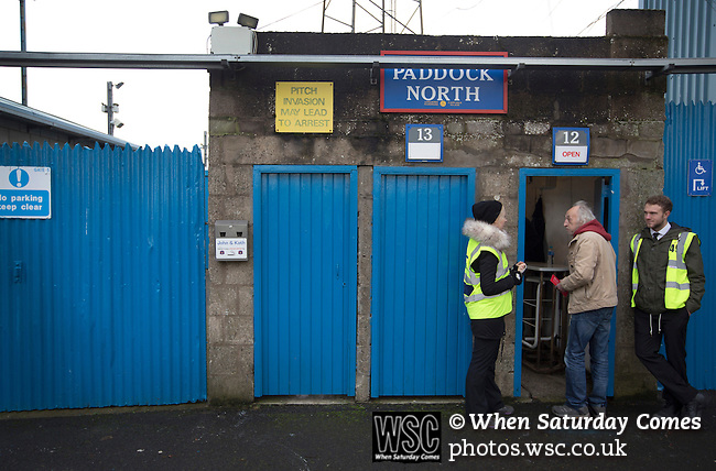 Carlisle United 1 Accrington Stanley 0, 15/11/2014. Brunton Park, League Two. A fan talking to a steward before entering the north paddock turnstiles prior to the English League Two match between Carlisle United and visitors Accrington Stanley at Brunton Park. The match was won by the home team by one goal to nil, the winner scored by Derek Asamoah in the 21st minute. The match was watched by 4,069 spectators. Photo by Colin McPherson.