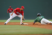 Shortstop Tzu-Wei Lin (36) of the Greenville Drive gets ready to tag Ryder Jones (15) of the Augusta GreenJackets in a game on Friday, July 11, 2014, at Fluor Field at the West End in Greenville, South Carolina. Lin is the No. 28 prospect of the Boston Red Sox, according to Baseball America. Greenville won, 7-6. (Tom Priddy/Four Seam Images)