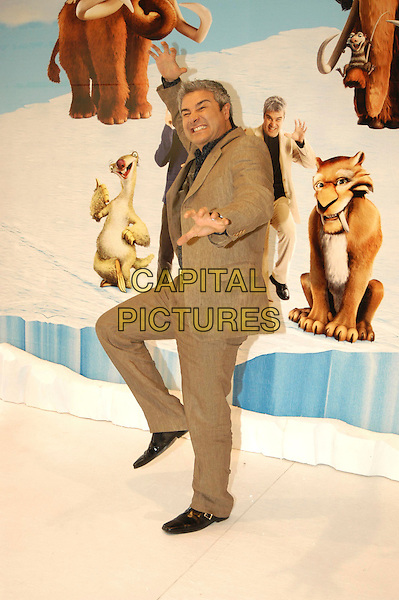 "PINO INSEGNO.Photocall for ""Ice Age: The Meltdown"" in Rome, Italy..April 13th, 2006.Ref: CAV.full length brown suit dancing funny.www.capitalpictures.com.sales@capitalpictures.com.© Capital Pictures."