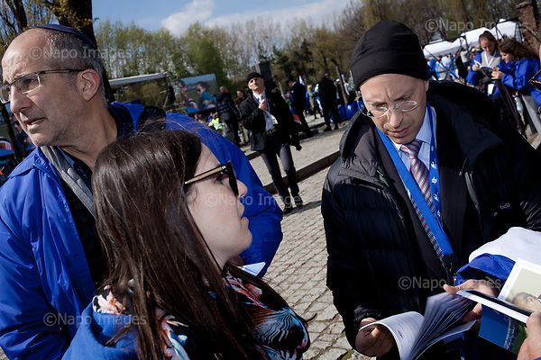 OSWIECIM, POLAND, APRIL 24, 2017:<br /> Elisha Wiesel, right at the camp in the &quot;March of The Living&quot; an annual march between two camps of the Auschwitz concentration camp.  Elisha Wiesel is a chief technology officer at Goldman Sachs in New York and the only son of Holocaust memoirist Eli Wiesel. After death of his father he has decided to step forward and take a more public role, carrying on his father's work.<br /> (Photo by Piotr Malecki / Napo Images)<br /> ###<br /> OSWIECIM, 24/04/2017:<br /> Elisha Wiesel, syn slawnego Eli Wiesela, bierze udzial w Marszu Zywych w Oswiecimiu. Po smierci ojca Elisha postanowil kontynuoawc jego dzielo.<br /> Fot: Piotr Malecki / Napo Images<br /> <br /> ###ZDJECIE MOZE BYC UZYTE W KONTEKSCIE NIEOBRAZAJACYM OSOB PRZEDSTAWIONYCH NA FOTOGRAFII###