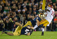 Linebacker Carlo Calabrese (44) and safety Austin Collinsworth (28) bring down USC Trojans wide receiver Nelson Agholor (15) in the second quarter.
