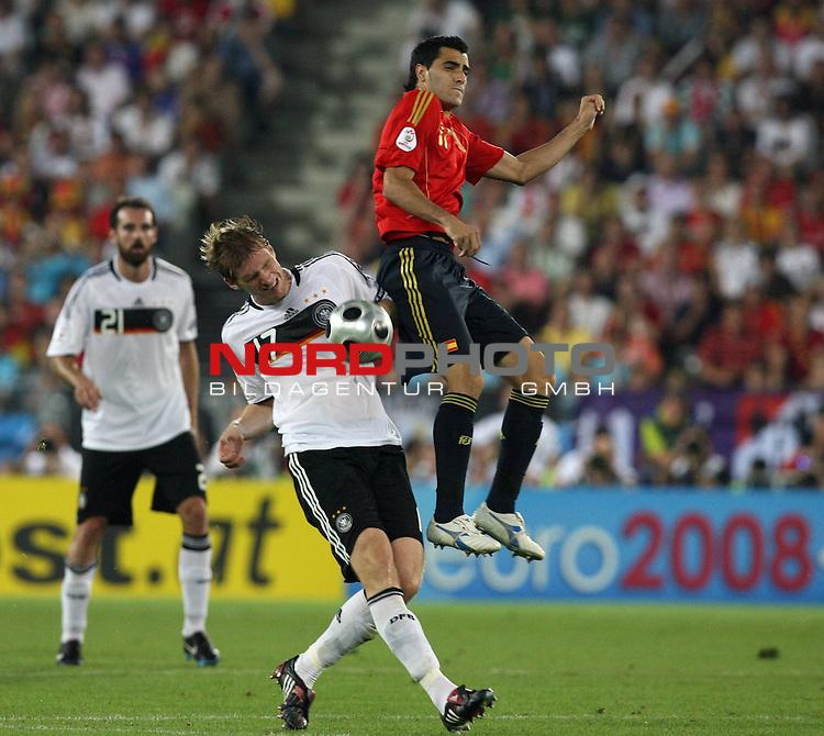 UEFA Euro 2008 Final Match 31 Wien - Ernst-Happel-Stadion. Deutschland ( GER ) - Spanien ( ESP ) 0:1. <br /> Per Mertesacker ( Germany / Verteidiger / Defender / Werder Bremen #17 ) im Kampf um den Ball mit Capdevila ( Spanien / Verteidiger / Defender / FC Villarreal #11 ) (r).<br /> Foto &copy; nph (  nordphoto  )