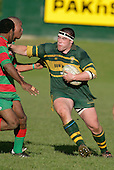 M. Hallsell fends off K. Faioso & P. Tavia. Counties Manukau Premier Club Rugby, Pukekohe v Waiuku  played at the Colin Lawrie field, on the 3rd of 2006.Pukekohe won 36 - 14