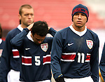 Brian Ching (11), of the United States, comes onto the field on a cold day, with teammates Kerry Zavagnin (5) and Jimmy Conrad (left), on Sunday, February 19th, 2005 at Pizza Hut Park in Frisco, Texas. The United States Men's National Team defeated Guatemala 4-0 in a men's international friendly.