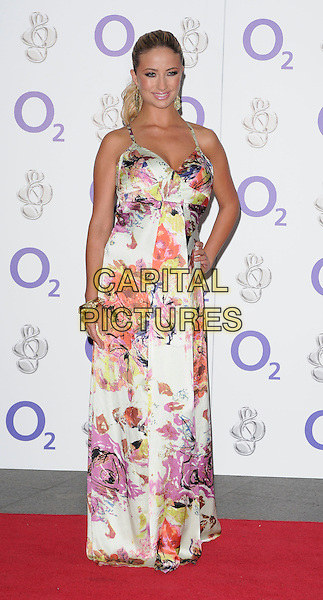 CHANTELLE HOUGHTON .At the Nordoff-Robbins O2 Silver Clef Awards, Hilton Park Lane Hotel, London, England, .3rd July 2009..full length long white floral print maxi dress  gold bracelet .CAP/CAN.©Can Nguyen/Capital Pictures