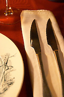 linen napkin and knives on a table set for dinner. at the gastronomic restaurant L'Enfance de Lard Bergerac Dordogne France
