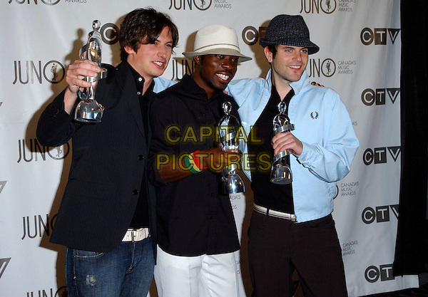 BEDOUIN SOUNDCLASH.The 35th Annual JUNO Awards held at the Halifax Metro Centre, Halifax, Nova Scotia, Canada. The JUNO Awards known as Canada's Music Awards are presented to Canada's best. .April 2nd, 2006.Photo: George Shepherd/AdMedia .Ref: GS/ADM.half length awards trophies hat blue black.www.capitalpictures.com.sales@capitalpictures.com.© Capital Pictures.