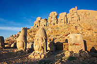 Pictures of the statues of around the tomb of Commagene King Antochus 1 on the top of Mount Nemrut, Turkey. Stock photos & Photo art prints. In 62 BC, King Antiochus I Theos of Commagene built on the mountain top a tomb-sanctuary flanked by huge statues (8–9 m/26–30 ft high) of himself, two lions, two eagles and various Greek, Armenian, and Iranian gods. The photos show the broken statues on the  2,134 m (7,001 ft)  mountain. 4