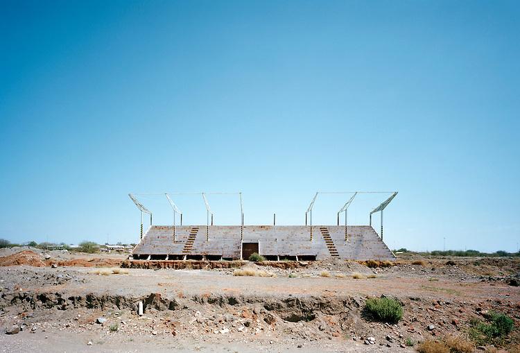 Patrick Tourneboeuf, Kimberley # 09. Tribune de sport abandonn&eacute;e sur l&rsquo;ancien stade d'une &eacute;cole sp&eacute;cialis&eacute;e dans la recherche de diamants. Afrique du Sud, septembre 2012.<br /> -----<br /> Patrick Tourneboeuf, Kimberley #09. Sports grandstand abandoned on the former stadium of a school specializing in search for diamonds. South Africa, September 2012.