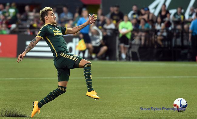 Jun 6, 2015; Portland, OR, USA; Portland Timbers midfielder Maximiliano Urruti (37) tries to control the ball during the second half of the game against the New England Revolution at Providence Park. The Timbers won the game 2-0. Mandatory Credit: Steve Dykes-USA TODAY Sports