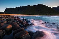 Waves crash against rocks at Unstad beach, Vestvågøy, Lofoten Islands, Norway