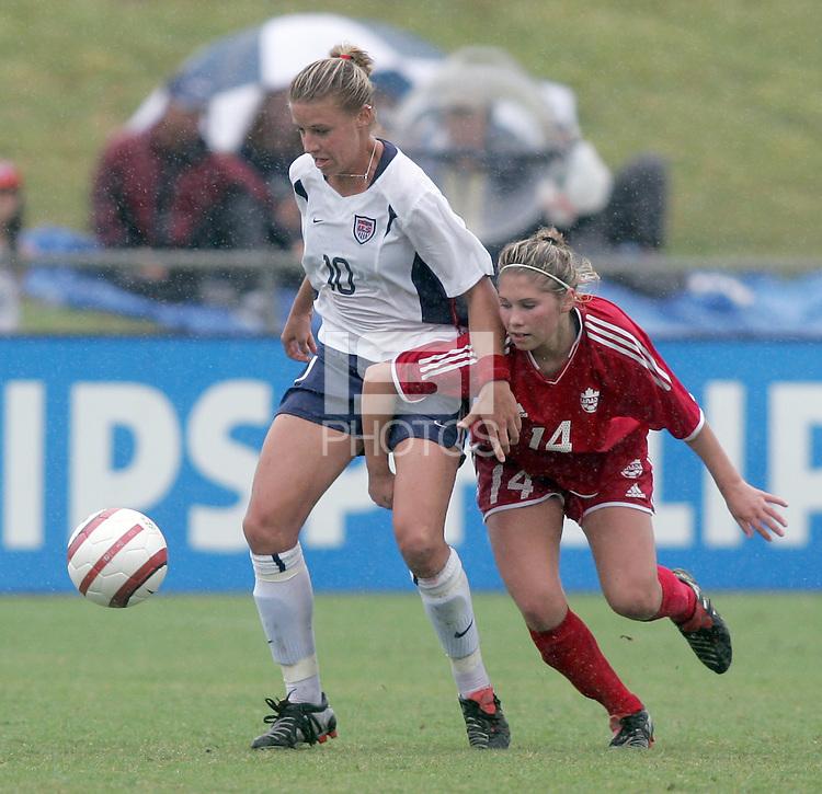 June 26, 2005; Virginia Beach, VA, USA;  USWNT midfielder Aly Wagner (10) holds off Canadian midfielder Amanda Cicchini (14) at the Virginia Beach SportsPlex.  The USWNT won, 2-0.
