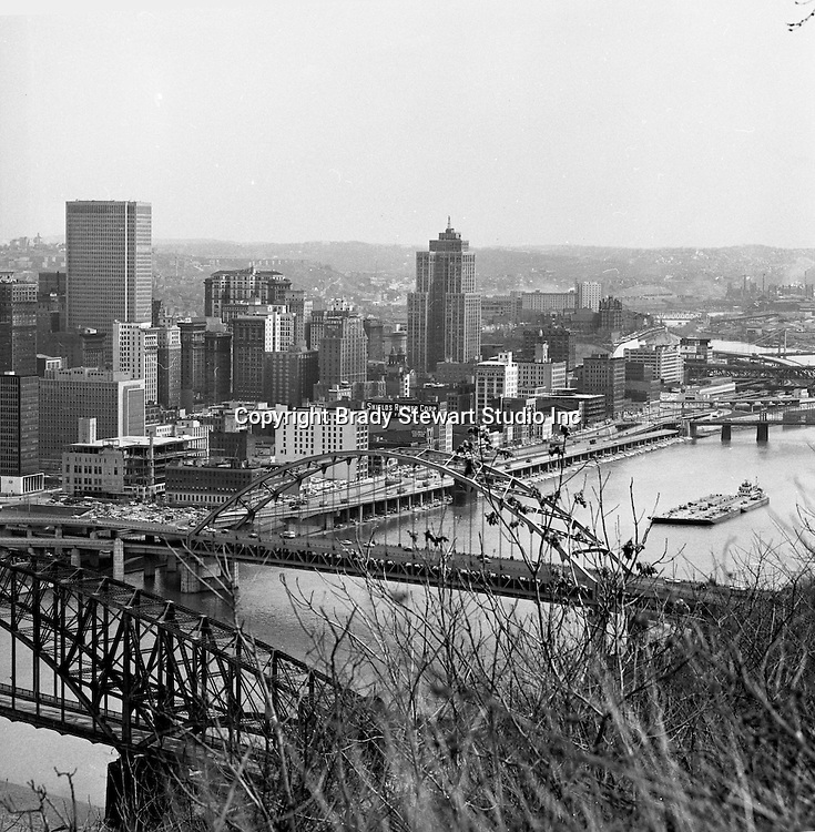 Pittsburgh PA:  View of the Pittsburgh skyline from Mount Washington - 1962.  View includes William Penn Place and Grant Buildings and Pittsburgh Press building under construction.