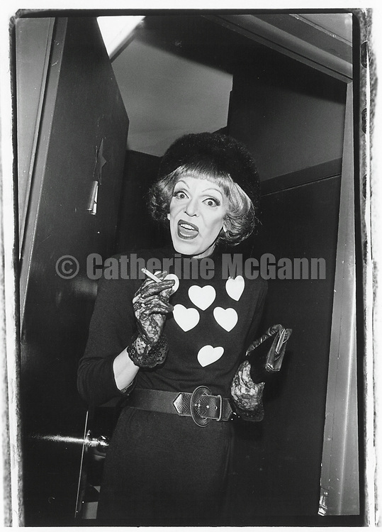 1992:  Bette Davis impersonator  Randy Allen poses for a portrait holding a cigarette in New York CIty.
