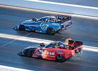 Nov 3, 2019; Las Vegas, NV, USA; NHRA funny car driver Matt Hagan (top) alongside Paul Lee during the Dodge Nationals at The Strip at Las Vegas Motor Speedway. Mandatory Credit: Mark J. Rebilas-USA TODAY Sports