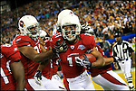 TAMPA, FL-.Arizona Cardinals wide receiver Larry Fitzgerald, at center, celebrates with teammates after scoring a second touchdown during the fourth quarter of Super Bowl XLIII at Raymond James Stadium in Tampa on Sunday, February 1st, 2009.  .(Photo by Brian Blanco/Bradenton Herald)