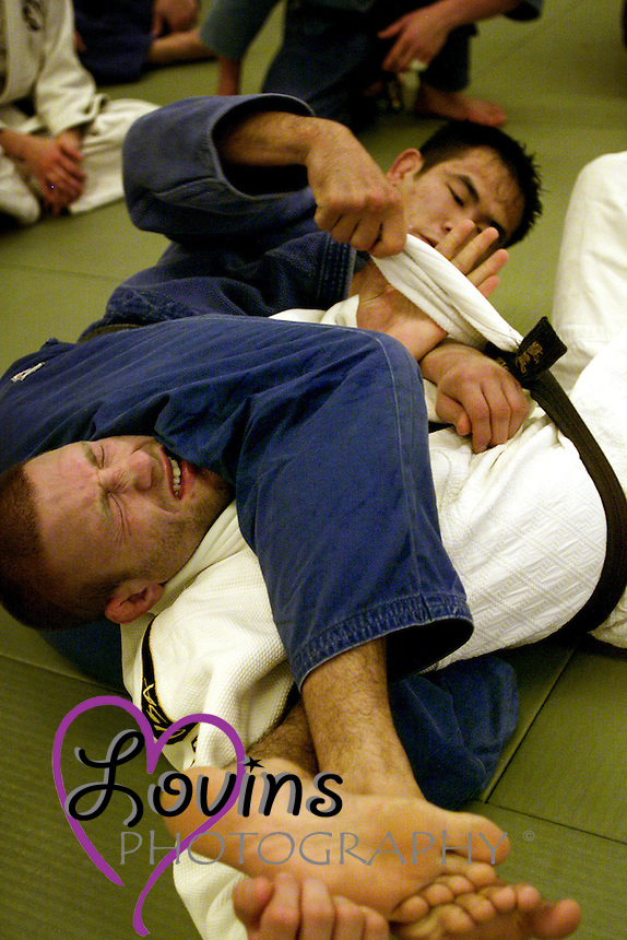 Tetsu Okano, an international business graduate student takes hold of Josh Resnick, a junior majoring in English, at a San Jose State University Judo Club practice in Yoshiro Uchida Hall.