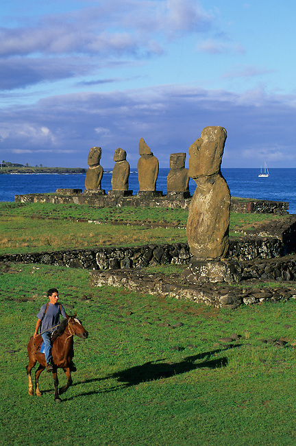CHILE, EASTER ISLAND, HANGA ROA, AHU TAHAI, LOCAL MAN ON HORSE