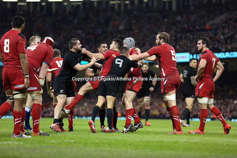 Pictured: A fight breaks out between Dane Coles (in black L) of New Zealand and Wales players Saturday 22 November 2014<br /> Re: Dove Men Series 2014 rugby, Wales v New Zealand at the Millennium Stadium, Cardiff, south Wales, UK.