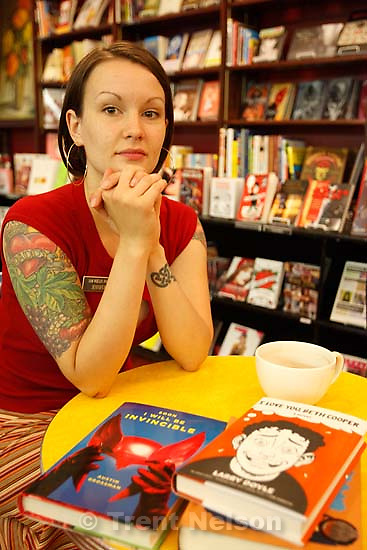 Salt Lake City - Sam Weller's Zion Bookstore employee Jennifer Nielsen, photographed in the store's new pop culture section. For an Arts cover feature on a recent publishing trend towards edgy, quasi-experimental fiction by 20-something authors. Many of these novels, influenced by today's visual-information society, incorporate artwork into the pages or blend text with comic strips to tell stories in new ways.