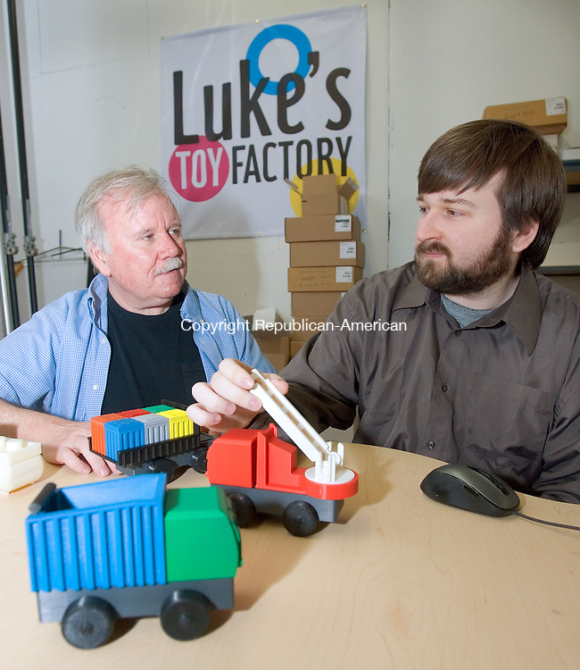 DANBURY CT. 19 May 2014-051914SV08-From left, James Barber and Luke Barber started a kickstarter campaign, to manufacture toys.&nbsp; They are shown here in their office in Danbury Monday.<br /> Steven Valenti Republican-American