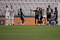 Memphis Depay of Lyon celebrates with team mates after scoring on penalty the goal of 0-1 during the Champions League round of 16 second leg football match between Juventus FC and Lyon at Juventus stadium in Turin (Italy), August 7th, 2020. <br /> Photo Federico Tardito / Insidefoto