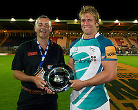 20130802 Copyright onEdition 2013 ©<br />Free for editorial use image, please credit: onEdition.<br /><br />Stuart Podmore (Head of Strategic Alliances, JP Morgan Asset Management) presents the plate to the winning captain Richard Mayhew of Newcastle Falcons 7s during the J.P. Morgan Asset Management Premiership Rugby 7s Series.<br /><br />The J.P. Morgan Asset Management Premiership Rugby 7s Series kicks off for the fourth season on Thursday 1st August with Pool A at Kingsholm, Gloucester with Pool B being played at Franklin's Gardens, Northampton on Friday 2nd August, Pool C at Allianz Park, Saracens home ground, on Saturday 3rd August and the Final being played at The Recreation Ground, Bath on Friday 9th August. The innovative tournament, which involves all 12 Premiership Rugby clubs, offers a fantastic platform for some of the country's finest young athletes to be exposed to the excitement, pressures and skills required to compete at an elite level.<br /><br />The 12 Premiership Rugby clubs are divided into three groups for the tournament, with the winner and runner up of each regional event going through to the Final. There are six games each evening, with each match consisting of two 7 minute halves with a 2 minute break at half time.<br /><br />For additional images please go to: http://www.w-w-i.com/jp_morgan_premiership_sevens/<br /><br />For press contacts contact: Beth Begg at brandRapport on D: +44 (0)20 7932 5813 M: +44 (0)7900 88231 E: BBegg@brand-rapport.com<br /><br />If you require a higher resolution image or you have any other onEdition photographic enquiries, please contact onEdition on 0845 900 2 900 or email info@onEdition.com<br />This image is copyright the onEdition 2013©.<br /><br />This image has been supplied by onEdition and must be credited onEdition. The author is asserting his full Moral rights in relation to the publication of this image. Rights for onward transmission of any image or file is not granted or implied. Changing or dele