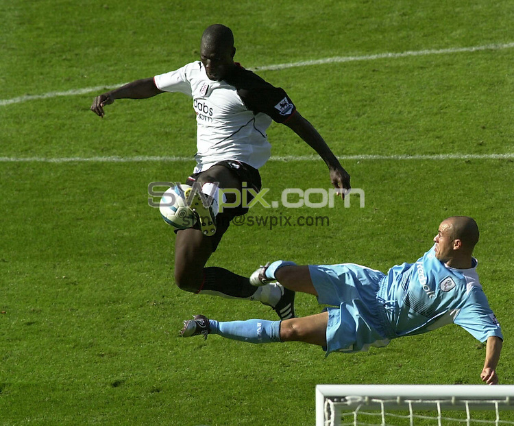 PIX: Football. FA Premiership. Fulham-Bolton Wanderers, Craven Cottage, London, 21st August 2004...COPYRIGHT PICTURE>> SIMON WILKINSON>>0870 092 0092>>....Stelios Giannakopoulos has a spectacular effort blocked by Papa Bouba Diop...