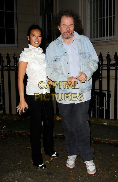 ROSEY CHAN & MIKE FIGGIS.June Sarpong's new website PoliticsAndTheCity.com launch party, Institute of Contemporary Arts, London, England..July 8th, 2008.politics and the city full length black jeans denim white ruffled ruffles frills blouse top blue shirt jean denim jacket grey gray trousers .CAP/CAN.©Can Nguyen/Capital Pictures.