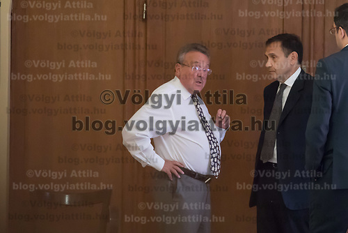 Tamas Gyarfas (R) vice-president of FINA swimming association and his lawyer Janos Banati (L) wait for ruling a court ruling connected to his arrest in a murder case in Budapest, Hungary on April 20, 2018. ATTILA VOLGYI