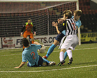 Barry Cuddihy thwarted by Finn Graham (2) and Chris Kane in the St Mirren v Dunfermline Athletic Scottish Professional Football League Under 20 match played at the Excelsior Stadium, Airdrie on 11.12.13.