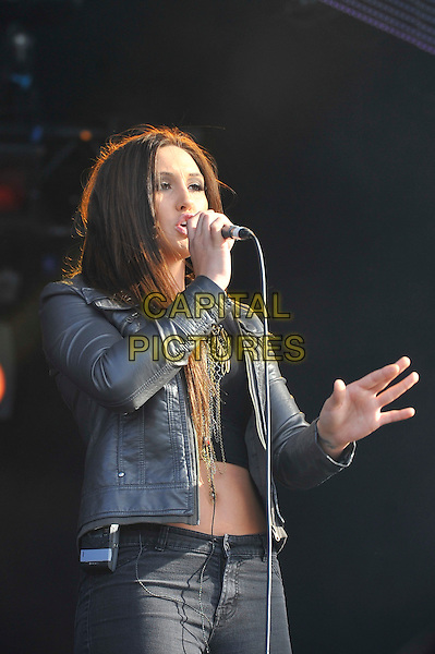 Alyssa Reid .Performing at BT London Live, Hyde Park, London, England. .5th August 2012.on stage in concert live gig performance music half length grey gray leather jacket black jeans denim singing hand arm belly stomach midriff .CAP/MAR.© Martin Harris/Capital Pictures.