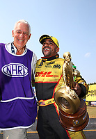 Sep 4, 2017; Clermont, IN, USA; NHRA funny car driver J.R. Todd (right) celebrates with photographer Jon Asher after winning the US Nationals at Lucas Oil Raceway. Mandatory Credit: Mark J. Rebilas-USA TODAY Sports