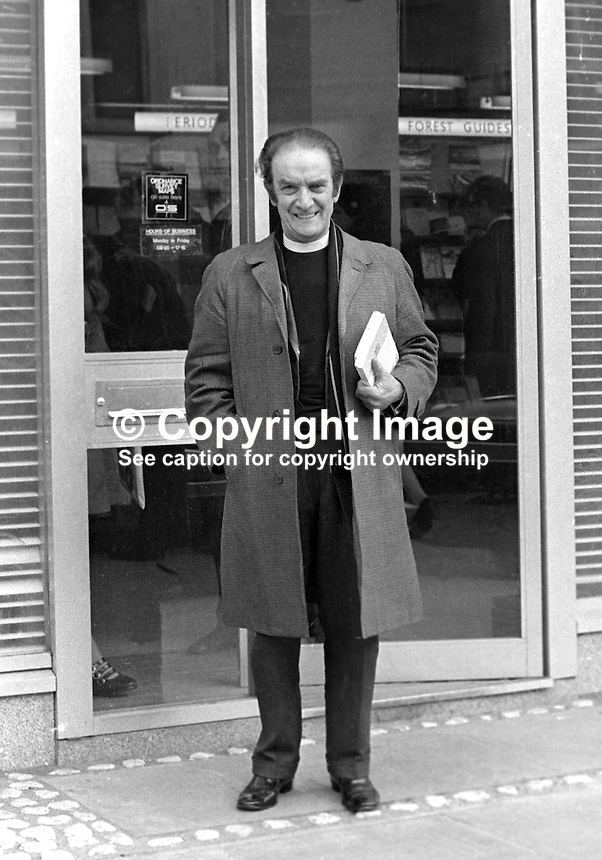 Rev Donald Gillies, Presbyterian Minister, Agnes Street, Protestant West Belfast, leaves the HMSO, Her Majesty's Stationery Office, aka Government Book Shop, in Belfast, N Ireland, after purchasing a copy of the Scarman Report, 6th April 1972. 197204060248DG.<br />