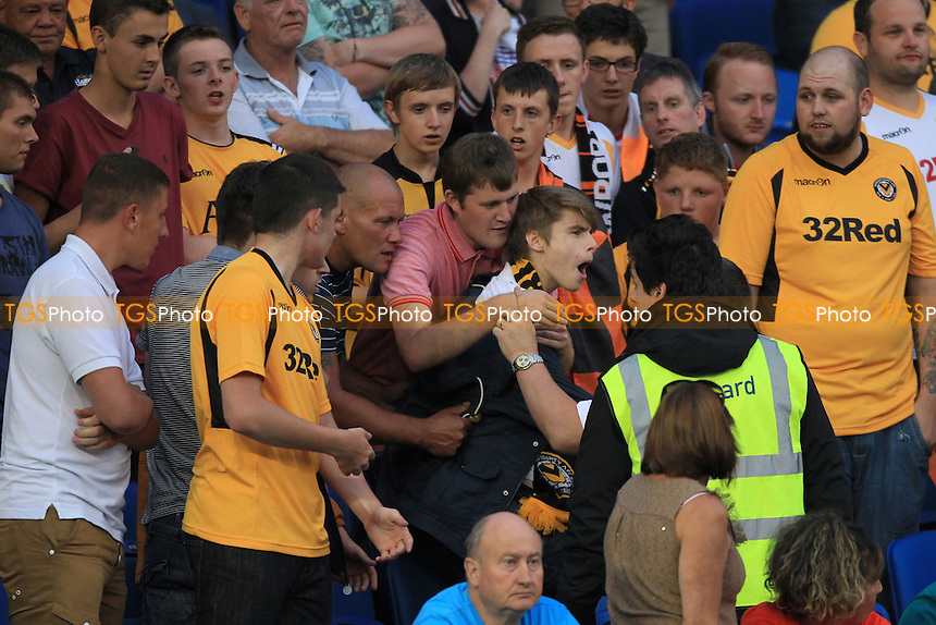 Newport County fan causes trouble - Brighton & Hove Albion vs Newport County AFC - Capital One Cup First Round Football at the Amex Community Stadium, Village Way, Brighton - 06/08/13 - MANDATORY CREDIT: Simon Roe/TGSPHOTO - Self billing applies where appropriate - 0845 094 6026 - contact@tgsphoto.co.uk - NO UNPAID USE