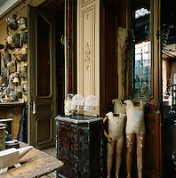 An eclectic mix of objects are arranged in a traditional panelled room.