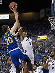 San Jose State forward Noah Baumann (20) shoots over Nevada  guard Nisre Zouzoua (5) in the second half of an NCAA college basketball game in Reno, Nev., Wednesday, Jan. 9, 2019. (AP Photo/Tom R. Smedes)