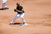 Dayne Parker (11) of the Wichita State Shockers steps on second base to turn a double play during a game against the Missouri State Bears in the 2012 Missouri Valley Conference Championship Tournament at Hammons Field on May 23, 2012 in Springfield, Missouri. (David Welker/Four Seam Images)