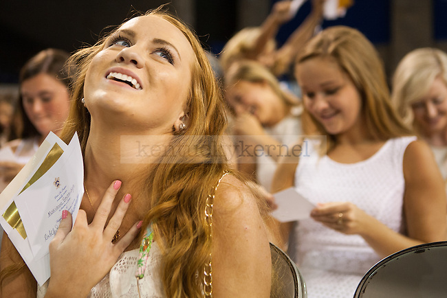 Marianne Beveridge reacts to her reception of a bid from Kappa Kappa Gamma during sorority bid day in Lexington, Ky. on Friday, August 21, 2015. Photo by Adam Pennavaria | Staff