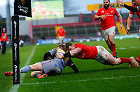 29th February 2020; Thomond Park, Limerick, Munster, Ireland; Guinness Pro 14 Rugby, Munster versus Scarlets; Chris Cloete of Munster drives Angus O'Brien of Scarlets in to touch