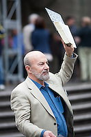 A man sells religion to the passing crowd during the 2011 NYC Easter Parade.