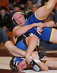 SPEARFISH, S.D. -- 174  L. J. Helbig, left, of the University of Wyoming scrambles with John Nething II of South Dakota State during their 174 lb. match Sunday at the Young Center in Spearfish, S.D.  (Photo by Richard Carlson/Inertia via dakotapress.org)
