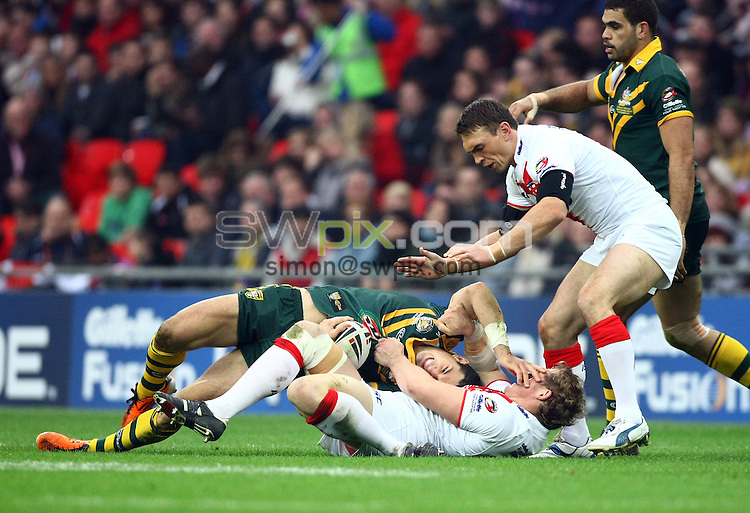 PICTURE BY VAUGHN RIDLEY/SWPIX.COM - Rugby League - Gillette 4 Nations 2011 - England v Australia - Wembley Stadium, London, England - 5/11/11 - Australia's Billy Slater is tackled by England's Ben Westwood.
