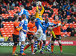 Dundee Utd v St Johnstone..26.12.12      SPL.Radoslaw Cierzniak gets above Gregory Tade and Frazer Wright;.Picture by Graeme Hart..Copyright Perthshire Picture Agency.Tel: 01738 623350  Mobile: 07990 594431