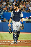 Seattle Mariners catcher John Jaso #27 during an American League game against the Toronto Blue Jays at the Rogers Centre on September 13, 2012 in Toronto, Ontario.  Toronto defeated Seattle 8-3.  (Mike Janes/Four Seam Images)