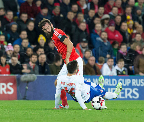 12.11.2016. Cardiff City Stadium, Cardiff, Wales. World Cup Qualifying Football. Wales versus Serbia. Wales midfielder Joe Ledley goes for the ball but leads to Referee Mr. Alberto Undiano Mallenco calling a foul on Serbia midfielder Luka Milivojevic.